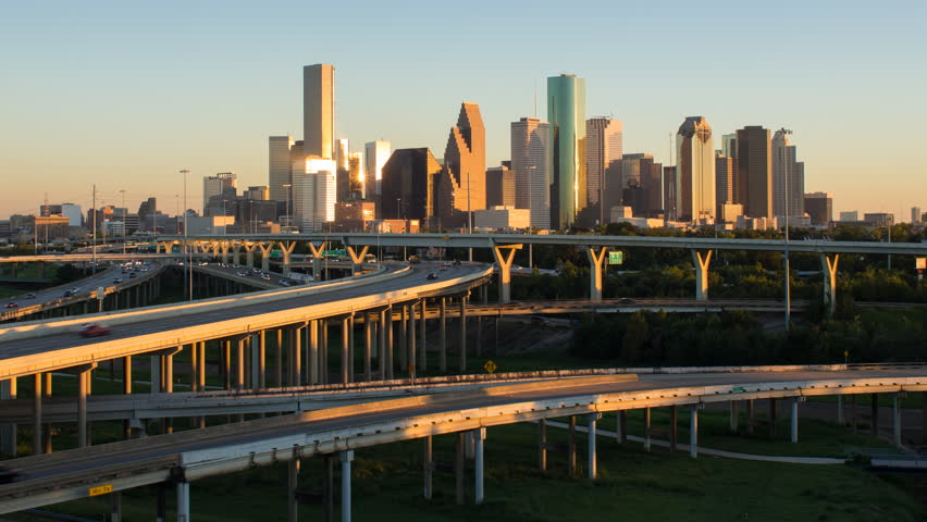 Houston - CIRCA DECEMBER 2013: Highway, city skyline, dusk to night