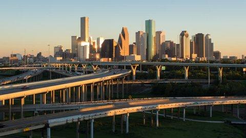 Houston - CIRCA DECEMBER 2013: Highway, city skyline, dusk to night