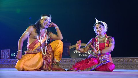 KONARK, INDIA - 3 DECEMBER 2014: Two unidentified dancers play a classic Indian love story on stage during the Konark Dance Festival.