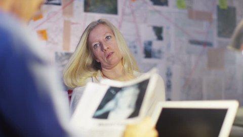 4K Police Detective interrogating female crime suspect in interview room