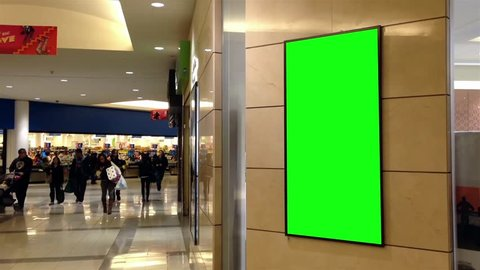 Burnaby, BC, Canada - April 04, 2015 : Green billboard for your ad on wall beside superstore.