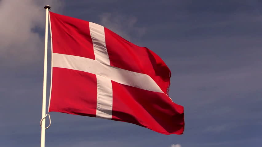 The Danish national flag, the Dannebrog flutters in a refreshing breeze in slightly reduced speed.