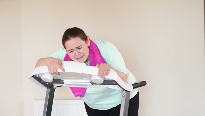 Fat woman running with perseverance on a treadmill