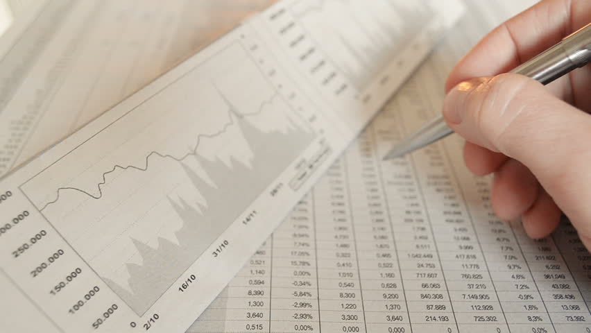 Close-Up Studying The Stock Market | Shutterstock HD Video #9536987