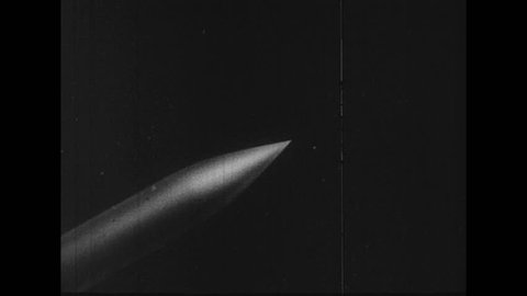UNITED STATES 1950s: Animation of satellite released in space.