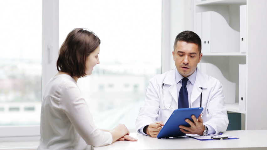 Medicine, health care and people concept - smiling doctor with tablet pc computer and young woman meeting at hospital | Shutterstock HD Video #9573158