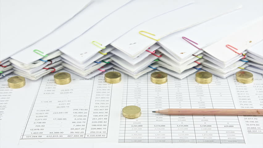 House with brown pencil between pile of gold coins on finance account have pile document with paperclip as background time lapse. Gold coins are increasing up as successful. Business concept footage. | Shutterstock HD Video #9576323