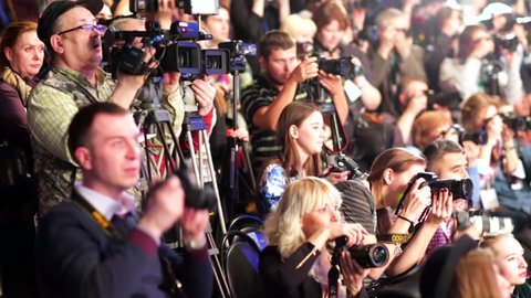 MOSCOW, RUSSIA - MARCH 26, 2015: Photographers crowd shoot models on a catwalk during Moscow Fashion Week in Gostiny Dvor.