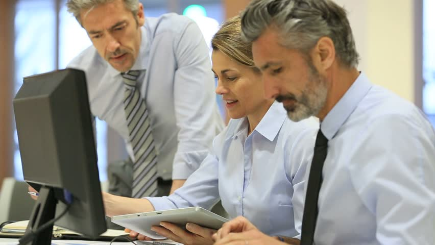Business people working in office on desktop computer | Shutterstock HD Video #9623843