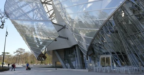 PARIS, FRANCE - APRIL 7, 2015: Louis Vuitton Foundation building entrance. Made of 3,584 laminated glass panels, it was designed by the architect Frank Gehry and opened to the public in 2014.