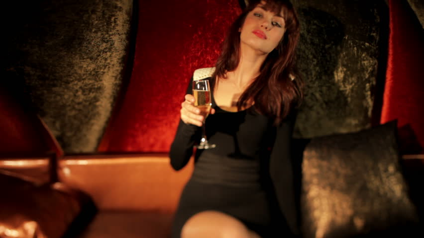 beautiful classic pinup girl in a VIP club drinking champagne and dancing