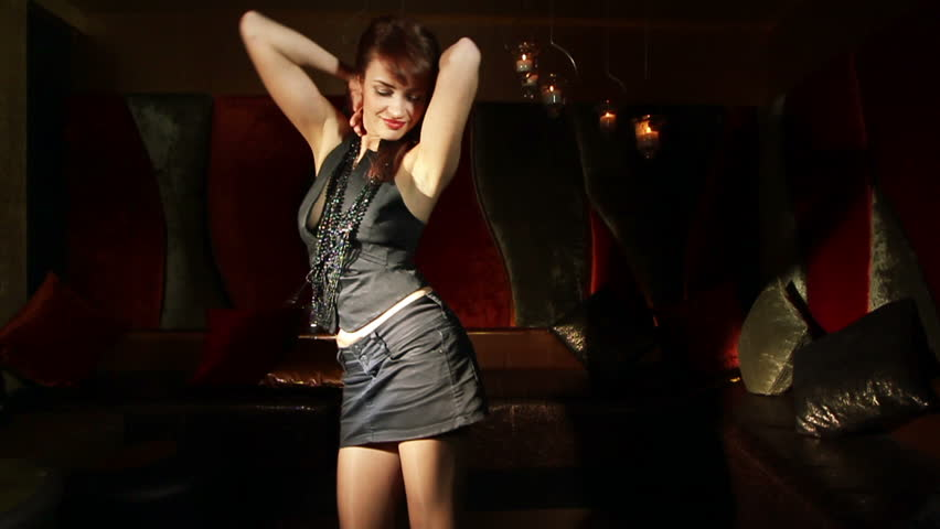 beautiful classic pinup girl in a  VIP club dancing, slow motion/over cranked