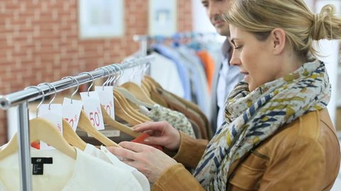 Mature couple doing shopping during sales season