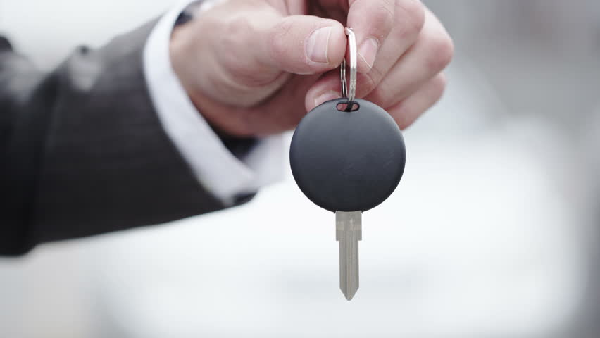 4K close up of new car keys being exchanged