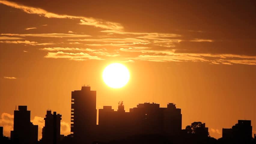 Sunrise, brazilian skyline. Silhouette buildings and golden sun. Time lapse.   | Shutterstock HD Video #9680339