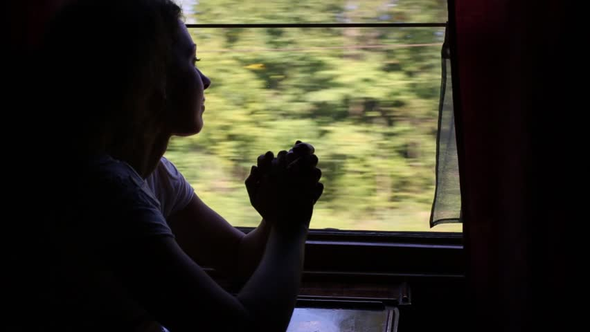 Dreaming young woman looks to window in moving train   Shutterstock HD Video #9688028