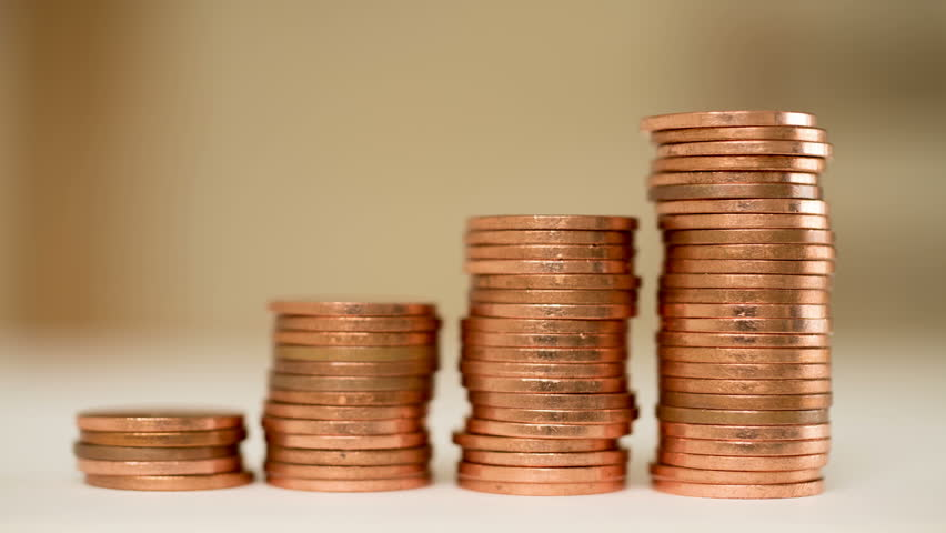 Rising columns of coins. Four stacks of copper coins build up. Like a bar graph of rising profit. | Shutterstock HD Video #9690833