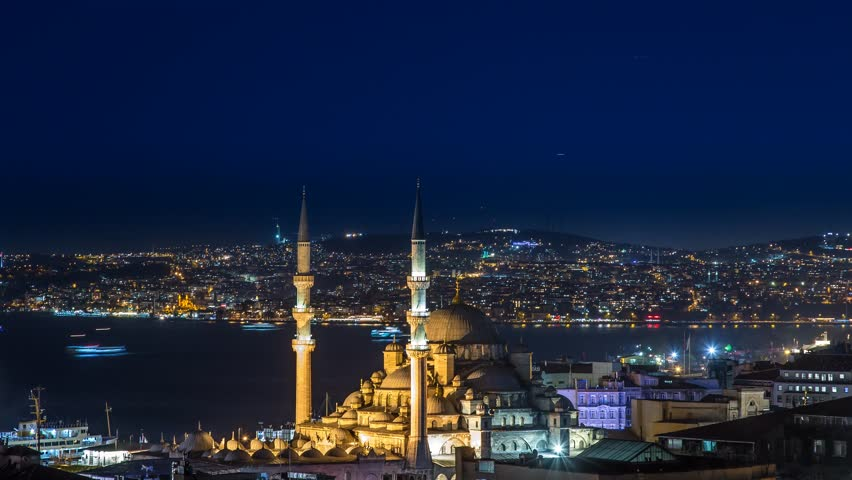 ISTANBUL - APRIL 03: Panoramic Time Lapse scene of the New Mosque in Istanbul with boat traffic in background by night. Time-Lapse in 4K. April 03, 2015 in Istanbul, Turkey.  | Shutterstock HD Video #9716375
