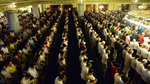 ISTANBUL, TURKEY - AUGUST 03: Tarawih prayers in Ramadan for Muslims Tunahan Mosque on August 3, 2013 in Istanbul, Turkey. Tunahan mosque, is a big mosque was opened for worship in 2004.
