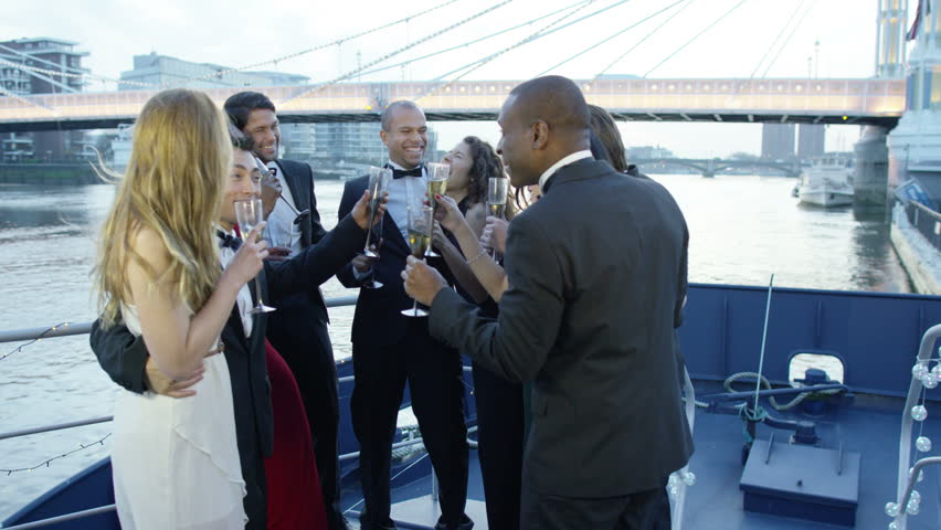 4K Happy diverse group of friends drinking champagne & having fun at boat party   Shutterstock HD Video #9743288