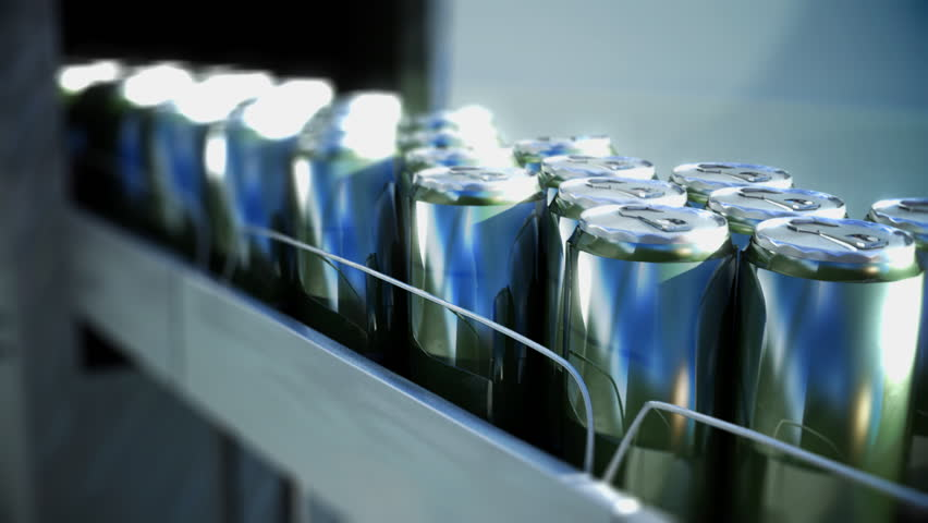 drink cans emerge from factory on conveyor belt