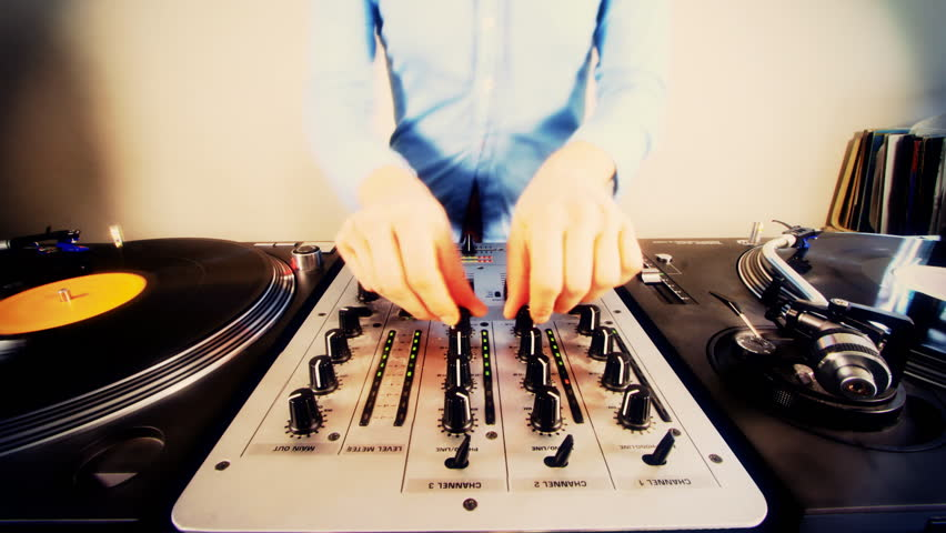 Close-up of female dj using mixer and turntables