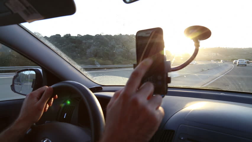 TEL-AVIV - APRIL 19, 2015: Using phone while driving