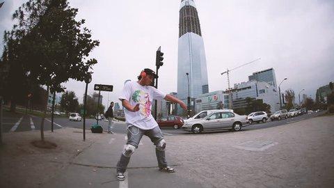 SANTIAGO DE CHILE - AUGUST 2013: A breakdancer busts a dance move routine in the Santiago de Chile urban downtown streets