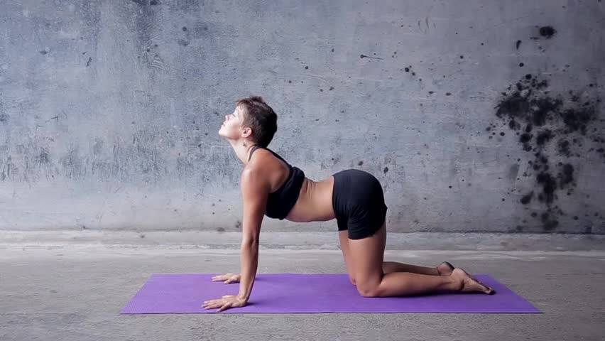 Stock Video Of Young Woman Practicing Yoga In A