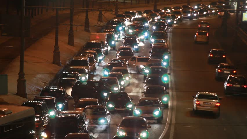 cars in hard traffic jam on wintry street of city at night