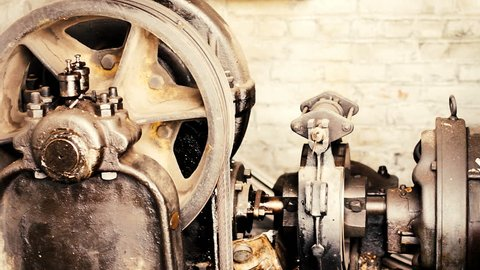 Old industrial machine with gears and pulleys