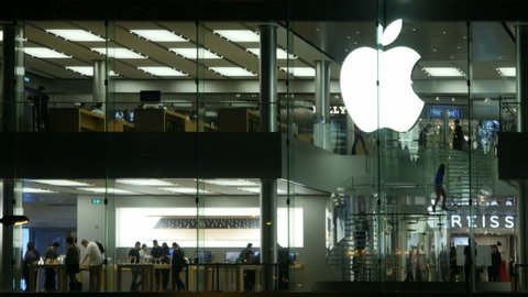 HONG KONG - CIRCA APRIL 2015: People attend Apple promotion show room in Hong Kong, POV, steadycam.