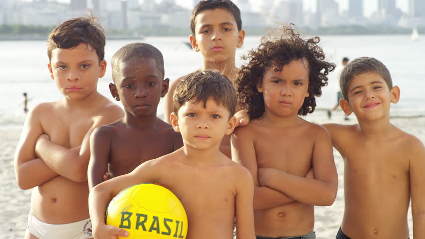 Brazilian Kids Pose With A Soccer Ball On A Beach K Stock Footage Clip